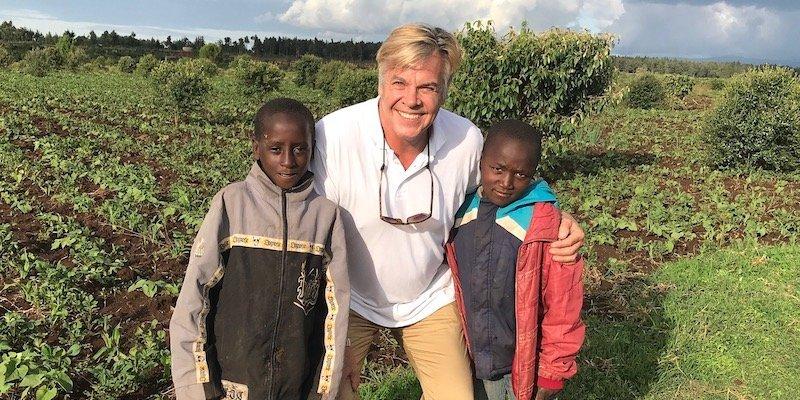 Chairman Ernie Williams with Mt Kenya Kids in garden -food security program-Innov8 Africa