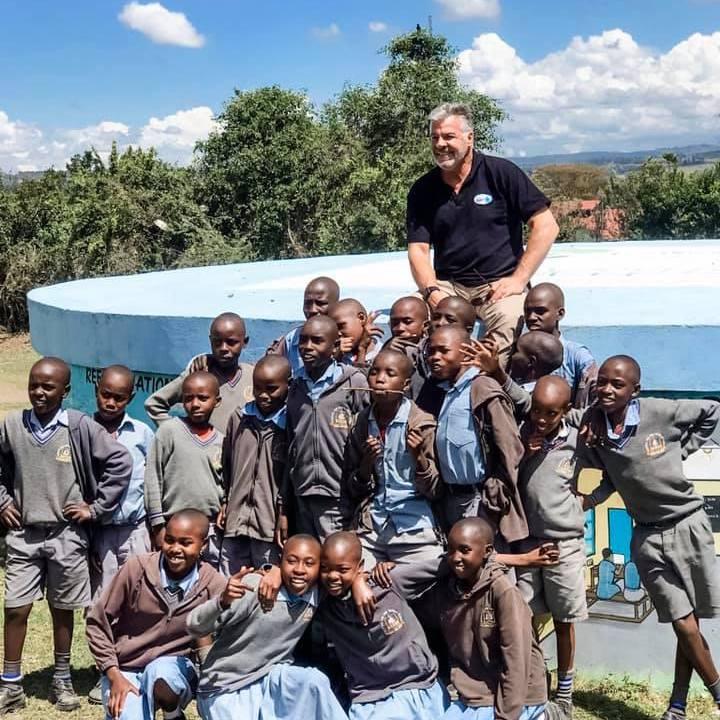 Children by water tank- Clean Water module -Innov8 Africa